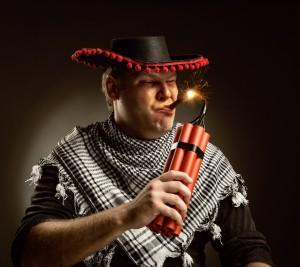 Cowboy mexican firing dynamite by cigar