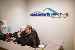 Colin taking a call at the Network Depot Front Desk